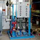 Custom condensate return packages and steam operated storage water heaters
